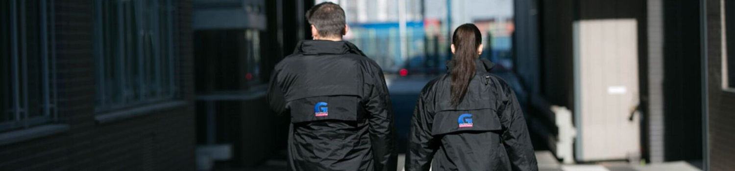 two private security agents walking