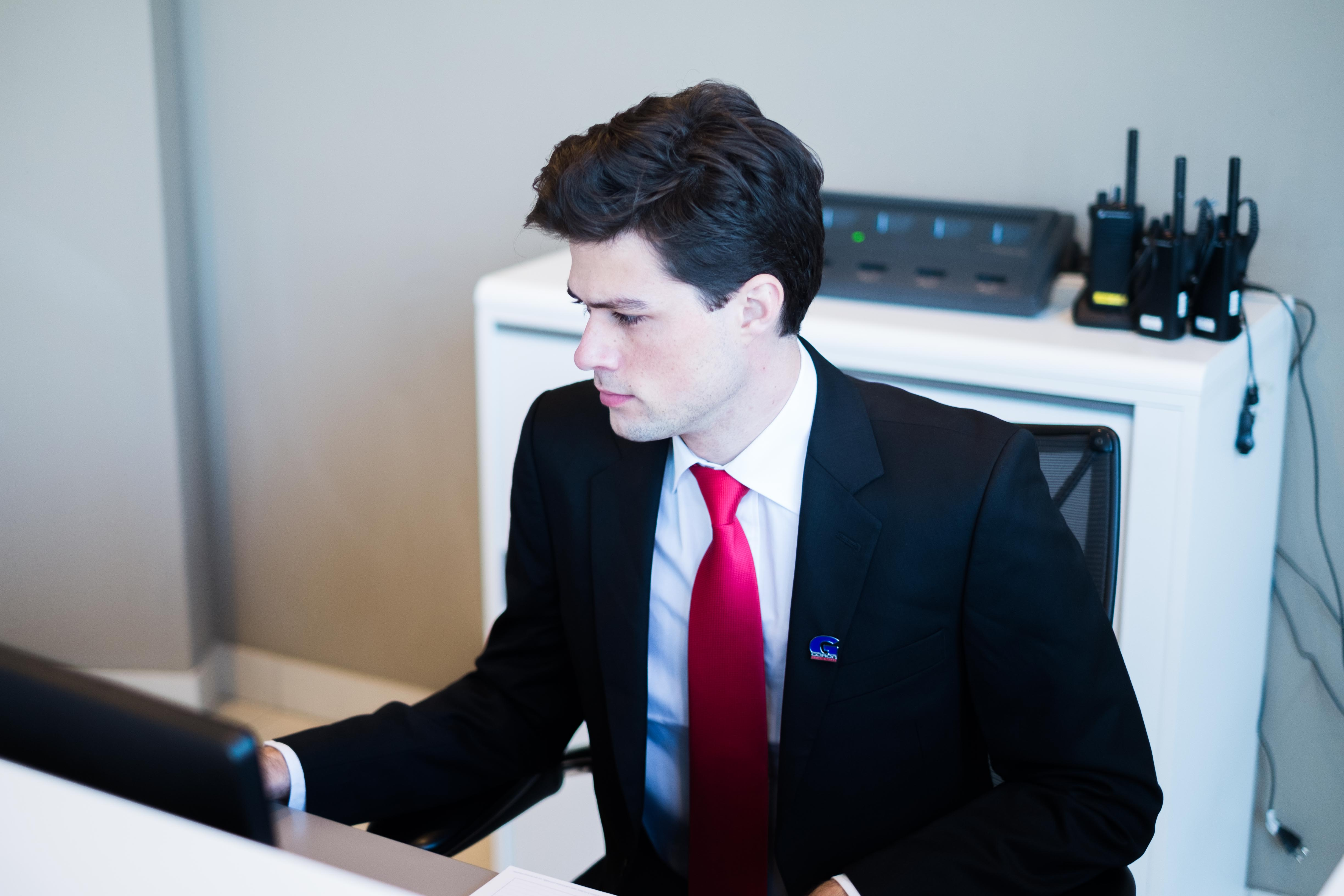 a security agent behind a desk